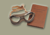 Aviator goggles and flight log book