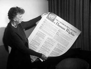 Eleanor Roosevelt admires United Nations Universal Declaration of Human Rights.