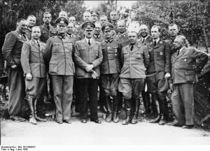 Adolf Hitler with his staff including Keitel, Jodl, Bormann, and others at Wolf's Lair.