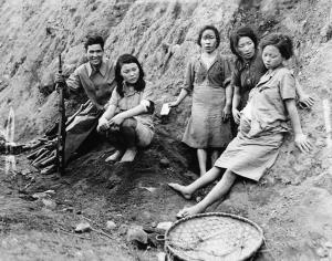 Four Korean comfort women (sex slaves), one pregnant, pose with a Chinese soldier who apparently helped free them from the Japanese.