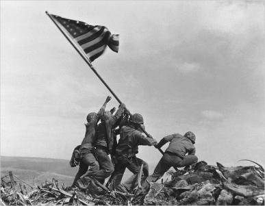 U.S. Marines of the 28th Regiment of the Fifth Division raise the American flag atop Mt. Suribachi.