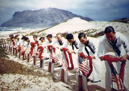 Following Hawaiian tradition, sailors honor men killed during the Japanese attack on Naval Air Station Kaneohe, Oahu.