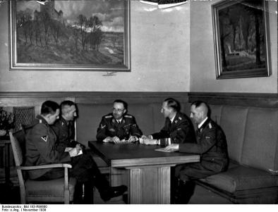 Himmler confers with Huber, Nebe, Heydrich and Müller.