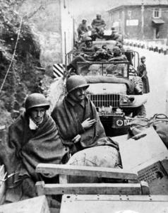 In a Dodge, the soldiers Isaltino Ribeiro da Silva and Eduardo Ramos de Oliveira cover themselves from the cold during the campaign of BEF, in Italy.