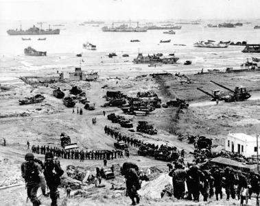 Reinforcements of men and equipment moving inland at Omaha Beach.