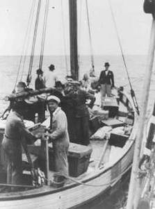 Danish fishermen ferry Jews into neutral Sweden during the German occupation of Denmark.
