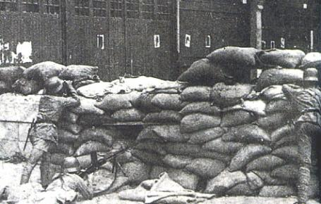 A section of a Chinese road blockade defended by the 87th Chinese Division in a street of Shanghai.