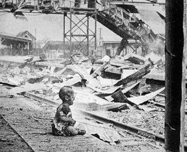 This terrified baby was one of the only human beings left alive in Shanghai South Station after the brutal Japanese bombing.