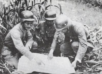 Officers of the Chinese 88th Division studying a map.
