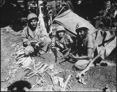 Navajo Indian communication men with the Marines on Saipan landed with the first assault waves to his the beach.