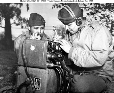 Preston Toledo and Frank Toledo, both Navajo Code Talkers and cousins, relay orders in the Navajo language on a field radio.